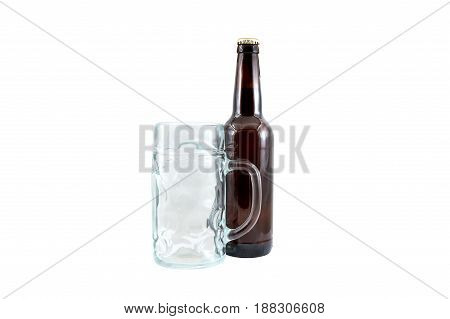 Bottle of beer with empty goblet for beer isolated on white.