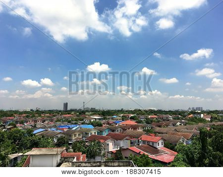 aerial view of home village against blue sky in thailand for lproperty real estate business background