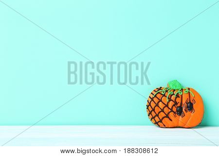 Fresh Halloween Gingerbread Cookies On Green Background
