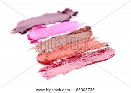 Stroke Of Lipsticks On A White Background