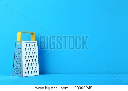 Metal Grater On The Blue Wooden Table