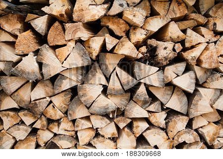 Stack of chopped firewood logs. Woodpile. Close up.