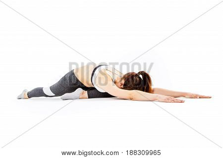 Sporty woman doing stretching exercises on empty white background