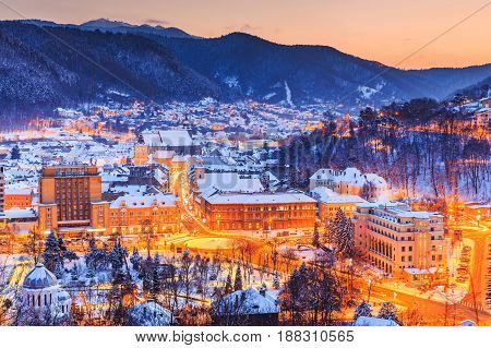 Brasov Romania. Old town during the winter at sunset.