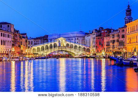 Venice Italy. Rialto bridge and Grand Canal at twilight.