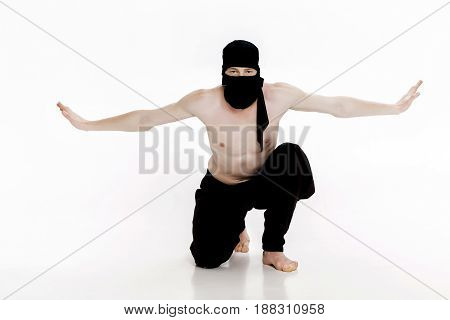 Ninja on a white background. Male fighter in black clothes