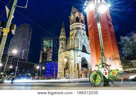 BERLIN GERMANY - APRIL 7: Traffic and ruins of Kaiser Wilhelm Memorial Church which was bombed during World war II on April 7 2017 in Berlin