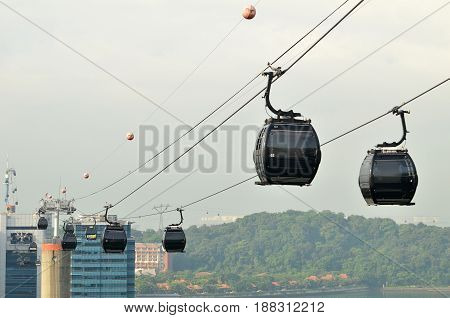 SINGAPORE - APRIL 29 2017: Cable cars from Singapore to Sentosa view from Mount Faber