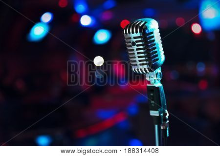 Retro microphone against blur colorful light restaurant background