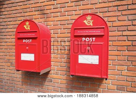 COPENHAGEN DENMARK - AUGUST 22 2014: Mail boxes on brick wall. Red old style mail boxes a common in Copenhagen and Denmark