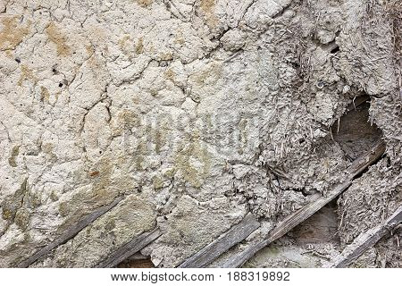 Vintage background texture. Wall national dwelling of straw and clay wattle and daub