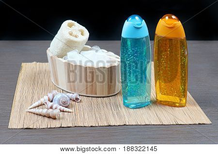Shower gel in sparkling containers with bath sponge
