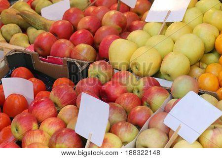 Fresh organic apples pile sold on market stall