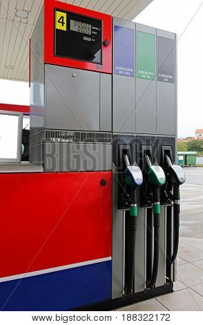 Gas station nozzles for filling into vehicles