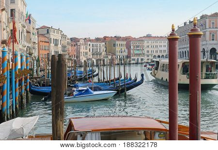 Traditional gondolas moored in Grand Canal in Venice