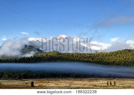 The fog rolls through Morraine Park and over the summitt of Longs Peak in Rocky Mountain National Park