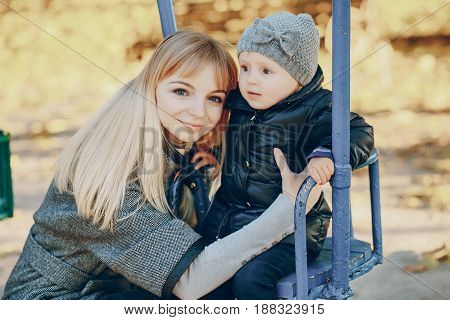 mother and little daughter in the autumn park