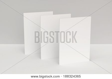 Three Blank White Closed Brochure Mock-up On White Background