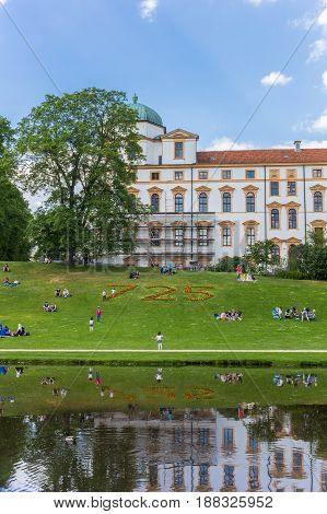 CELLE, GERMANY - MAY 21, 2017: People sitting in the grass in front of the castle of Celle, Germany