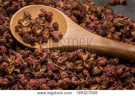 Wooden Spoon In Szechuan Peppercorns