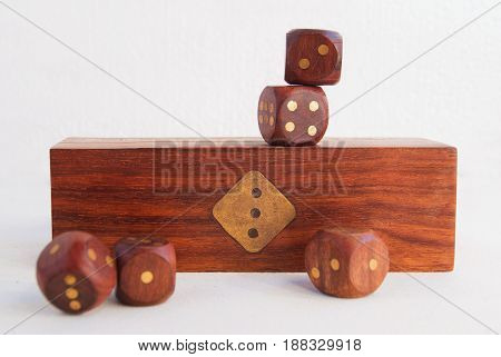 Set Of Dice On The Background Of A Wooden Box