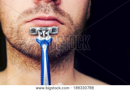 Closeup Of A Razor On His Chin Stubbly.