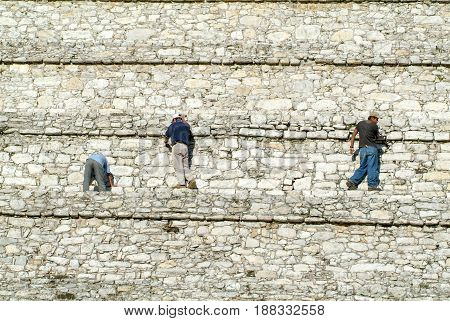 People Who Restore The Wall Of The Pyramid At Palenque
