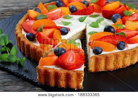 Cake Topped With Strawberries,blueberries, Mint