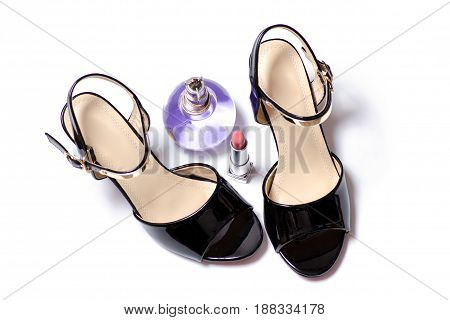 Black female sandals and perfume on white background isolation