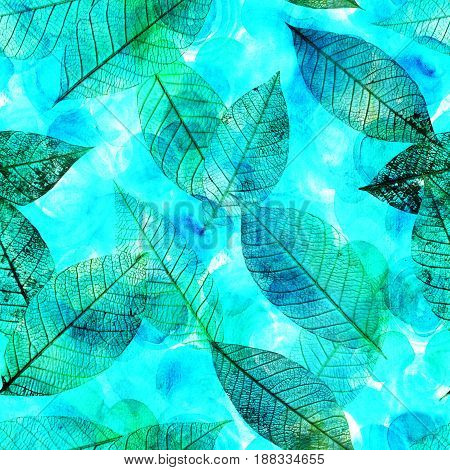 A seamless background pattern of skeleton leaves on a teal watercolor texture, autumnal repeat print
