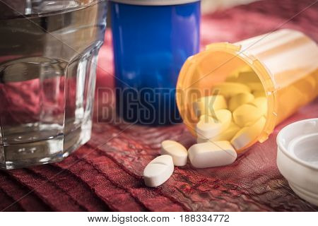 White Pills Spilling From An Open Ambar Bottle