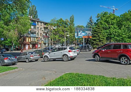 Dnipro Ukraine - May 17 2017: Illegal parking on a sidewalk in downtown Dnipro. Violation of parking rules and rights of pedestrians with the full connivance of authorities and inactivity of the police