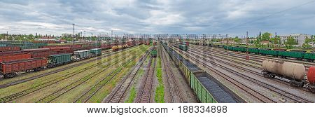 Panoramic view of the urban junction railway yard on which sorting of freight railway trains takes place