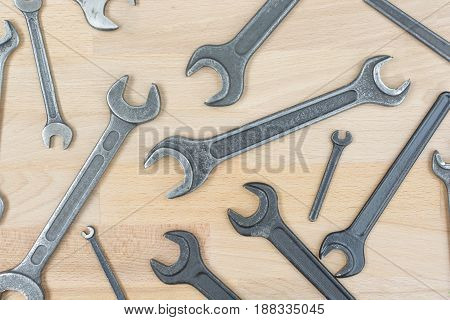 Scattered Old Spanners On A Wooden Table
