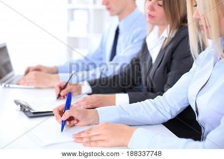 Group of business people working together in office.