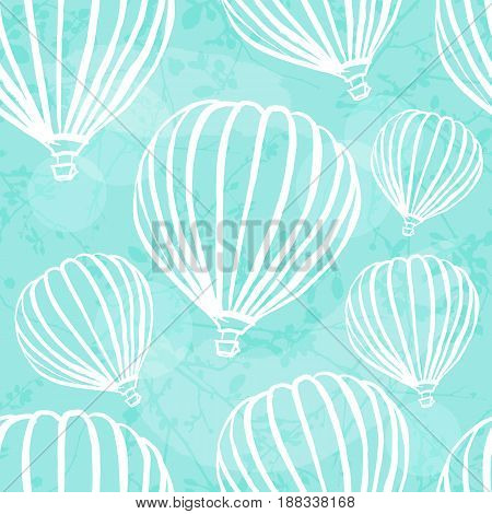 A freehand retro style seamless pattern with hot air balloons in a teal blue sky with brush strokes