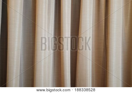 brown curtain ideal for backgrounds and textures