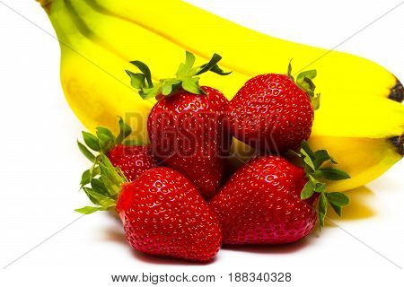 Isolated Fruits. Bunch Of Bananas And Pile Of Strawberries Isolated On White Background