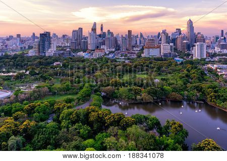 Sunset scence of Bangkok skyline Panorama Aerial view of Bangkok modern office buildings and condominium in Bangkok city downtown with sunset sky and clouds at Bangkok Thailand. Lumpini park