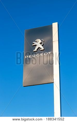 Moscow Russia - May 14 2016: Official dealership sign of Peugeot against the blue sky background. Peugeot is a French car brand automotive manufacturer
