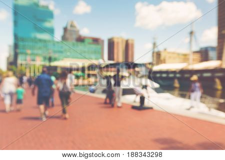 Abstract Blurred People Walking At The Inner Harbor Of Baltimore