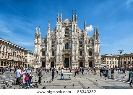 MILAN, ITALY - MAY 16, 2017: Tourists vizit the Milan Cathedral (Duomo di Milano) on the Piazza del Duomo. Milan Duomo is the largest church in Italy.