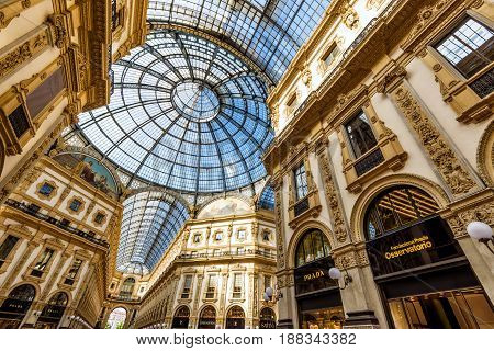 MILAN, ITALY - MAY 16, 2017: Prada adn other stores in the Galleria Vittorio Emanuele II in central Milan. This gallery is one of the world's oldest shopping malls.