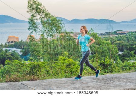 A Sportive Young Woman Is Engaged In Running Against The Sea
