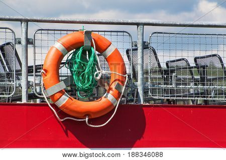 A rescue ring on the cruise ship's railing. Rescue the drowning. Safety equipment