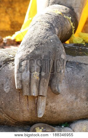 close-up ruined ancient buddha statue hand at Sukkothai, Thailand, broken, damaged, buddha, finger missing