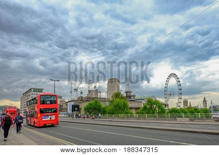 Waterloo Bridge London England - May 2 2017: View of the road on Waterloo Bridge with bues the London Eye and lots of cranes.