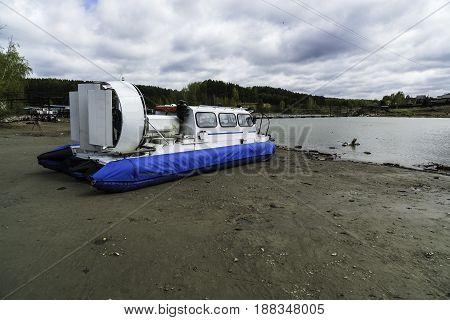 Hovercraft on the river bank. Siberia, Razdelnaya River, Novosibirsk Region, Berdsk