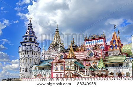 Izmailovsky Kremlin rebuild imperial manor. White stone manor architecture with classic traditional Russian style ornaments elements painting. Colorful gingerbread houses cottages. Fairy palace castle. Gingerbread cottages