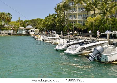 Key West Florida Keys Florida USA - May 15 2017 : Motor boats and jet skis moored up in Key West Marina